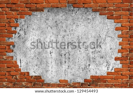 Hole in Brick Wall with scratched plaster background