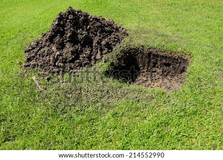 Hole in Ground for Installation of New PVC Pipes for in ground Sprinkler System in a Yard - stock photo