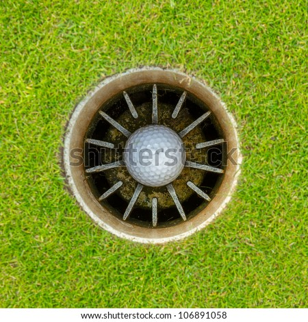 Hole in One - Golf ball in the cup - stock photo