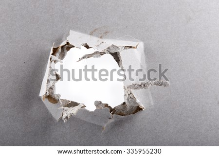hole in plasterboard wall closeup - stock photo