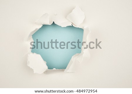 Hole in the beige paper. Abstract background