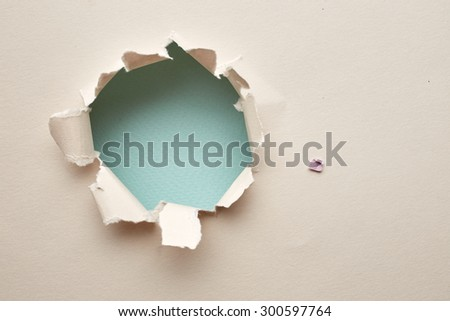 Hole in the paper. Abstract background - stock photo