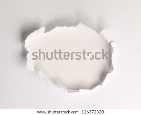 Hole in the paper with torn - stock photo