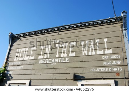 hole in the wall building - stock photo