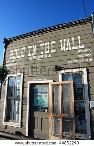 hole in the wall store - historical - stock photo
