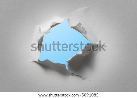 hole in white paper