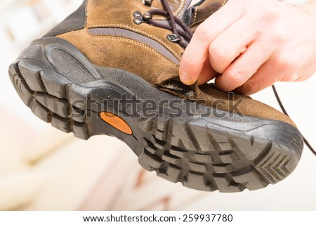 Hole in worn old shoe - stock photo