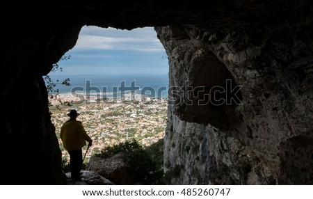 Hole of Denia with tourist from water cave