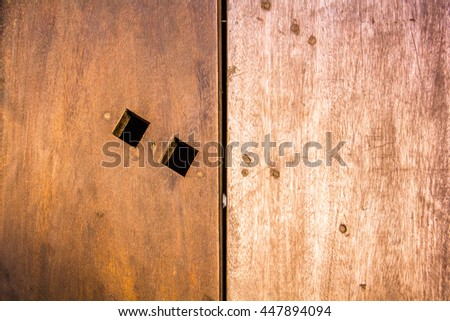 hole on the wooden floor