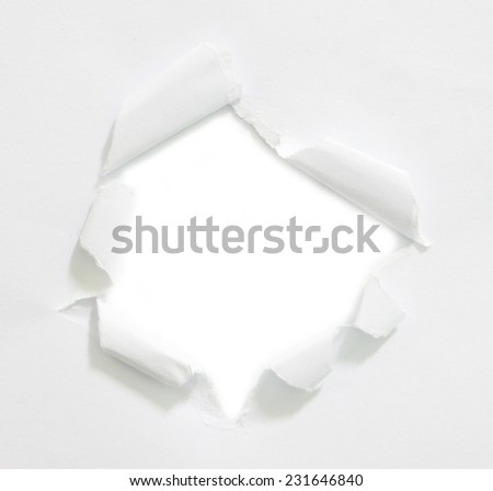 Hole ripped in paper on white background with copy space