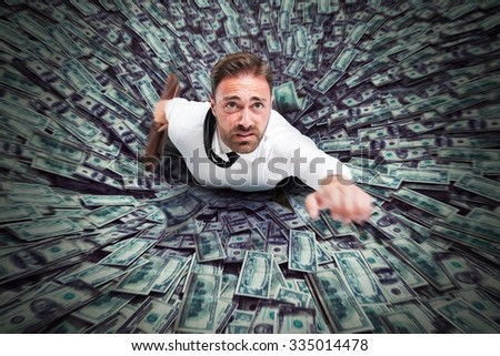 Hole that sucks a businessman and money - stock photo