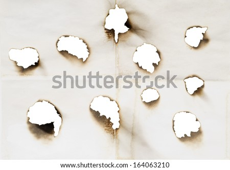 holes in a paper isolated on a white