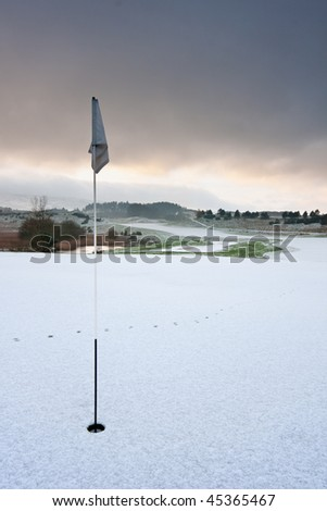 Holeside view on a golf course in Scotland on a snowy winter morning. - stock photo