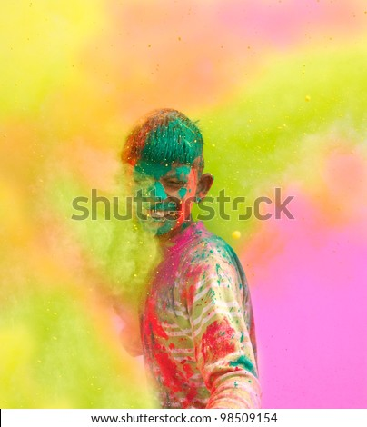 Holi celebrations - Closeup of a boy playing Holi in India. - stock photo