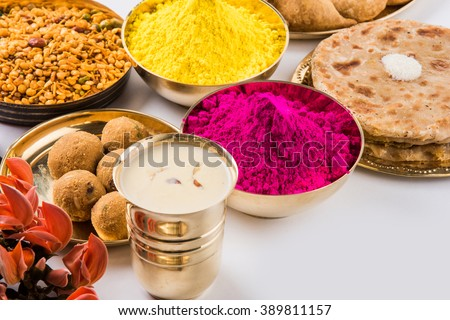 holi festival food with colours, indian festival holi, samosa, kachori, laddu, gujiya, palash flower, thandai, farsan, puran poli or roti, indian festival of colours called holi