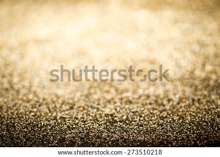 Holiday abstract glitter background with blinking lights and gold defocused texture. Golden Glitter festive  - stock photo