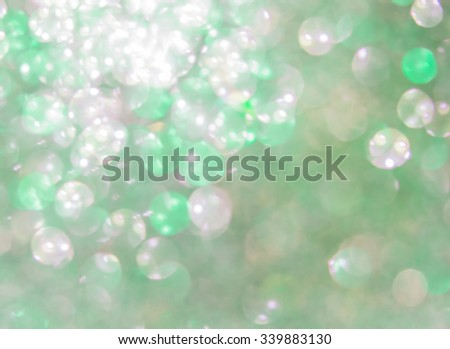 Holiday abstract green glitter defocused background with blinking stars. Blurred bokeh - stock photo