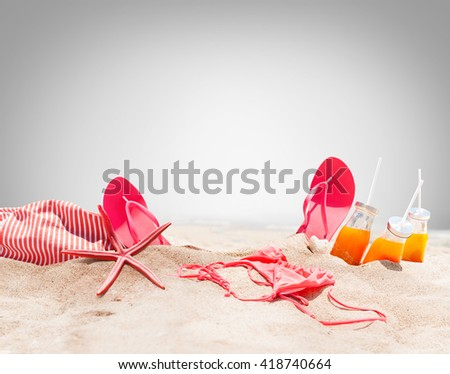 Holiday Accessories on Sand Beach Orange Juice Bikini Slippers Sea Star Sunny Summer Day Relax Concept Art Collage isolated on grey Background - stock photo