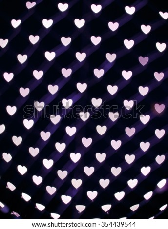Holiday and celebration background with Bokeh heart light - stock photo