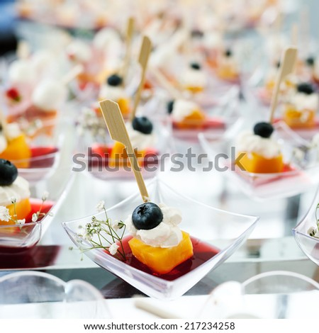 Holiday Appetizers banquet table setting in restaurant - stock photo