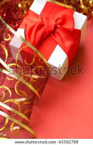 Holiday background with gift box and red ribbons. Still life.
