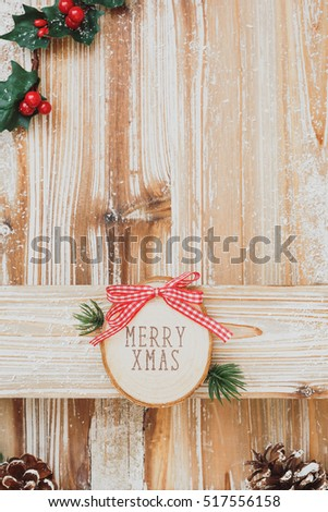 Holiday background with Merry Xmas wood sign, on wooden wall. Top view, blank space