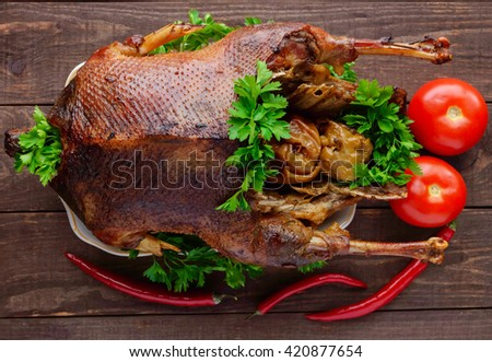 Holiday Baked goose with apples. The top view. - stock photo