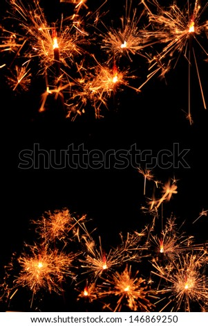 holiday black background with sparklers - stock photo