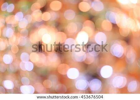 Holiday blurred bokeh background. Christmas background. Horizontal. Warm beige tone with light lilac and green - stock photo