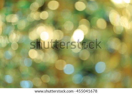 Holiday blurred bokeh background. Christmas background. Horizontal. Warm green tone with yellow - stock photo