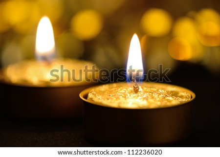 Holiday candles. Blurred background. Gold tone - stock photo