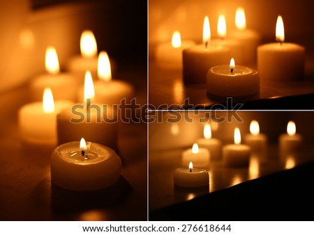 Holiday candles burning on a white background and reflected