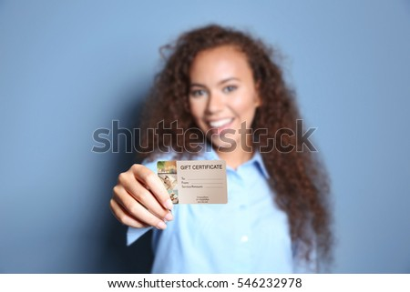 Holiday celebration concept. Woman showing spa service gift certificate