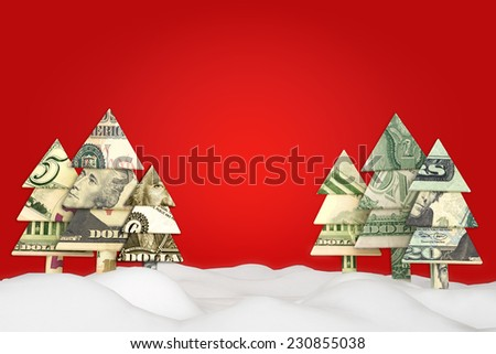 Holiday Christmas savings or sale advertisement. Origami money Christmas tree's in the snow with a red background with room for text or copy space.  - stock photo