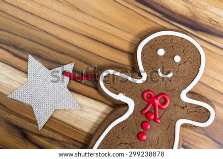 holiday classic, a gingerbread man cookie on a wooden table