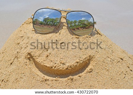 Holiday concept with smile sand  on the seaside - stock photo