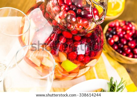 Holiday cranberry sangria with apples and cinnamon.