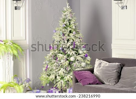 Holiday decorated room with Christmas tree - stock photo