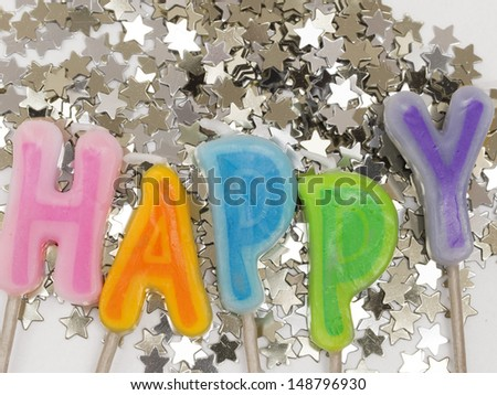 Holiday decoration with word HAPPY - stock photo
