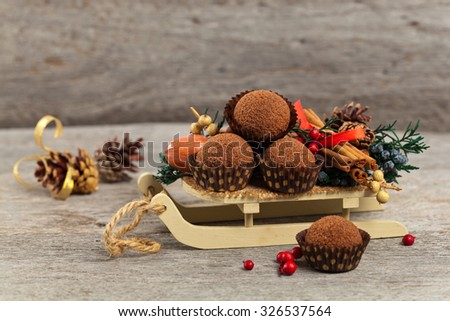 Holiday Decorations. Christmas background with Chocolate Cocoa Honey Balls. Selective focus. - stock photo