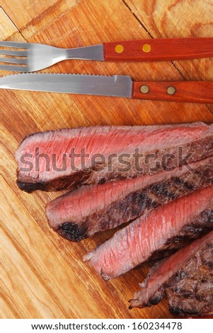 holiday dinner meat food : roast beef steak on wood plate isolate on white background - stock photo