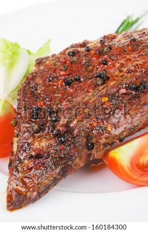 holiday evening dinner roast meat shoulder on white with tomatoes chives and green lettuce isolated on white background