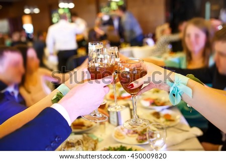 Holiday Event people cheering each other with champagne. - stock photo