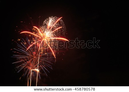 Holiday fireworks in night sky with copy space. - stock photo