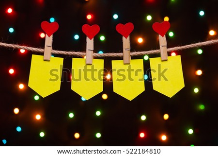 holiday flags  with hearts on the background of colored lights