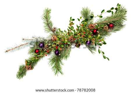 Holiday garland with ornaments, pine & spruce branches, pine cones and evergreen with berries (Common Bearberry/Kinnikinnick) Shot straight down but at an angle to get maximum length in frame. - stock photo