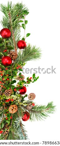 Holiday garland with red ornaments, pine & spruce branches, pine cones and evergreen with berries (Common Bearberry/Kinnikinnick). - stock photo