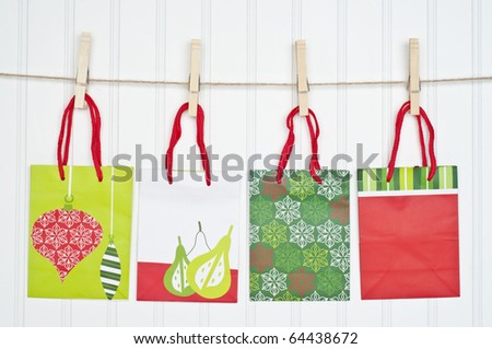 Holiday Gift Bags on a Clothesline.  Holiday Concept. - stock photo