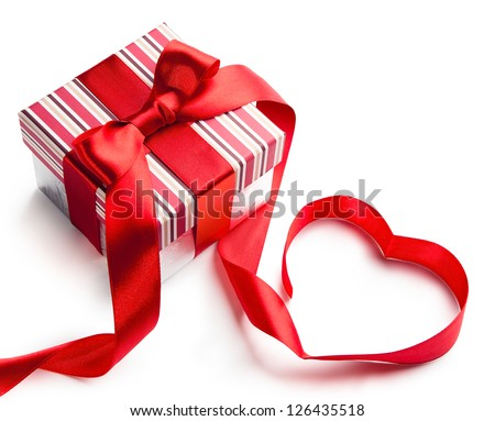 holiday gift box with red ribbon in the shape of a heart isolated on white background - stock photo