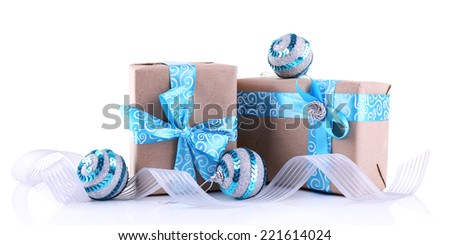 Holiday gift boxes decorated with blue ribbon isolated on white - stock photo